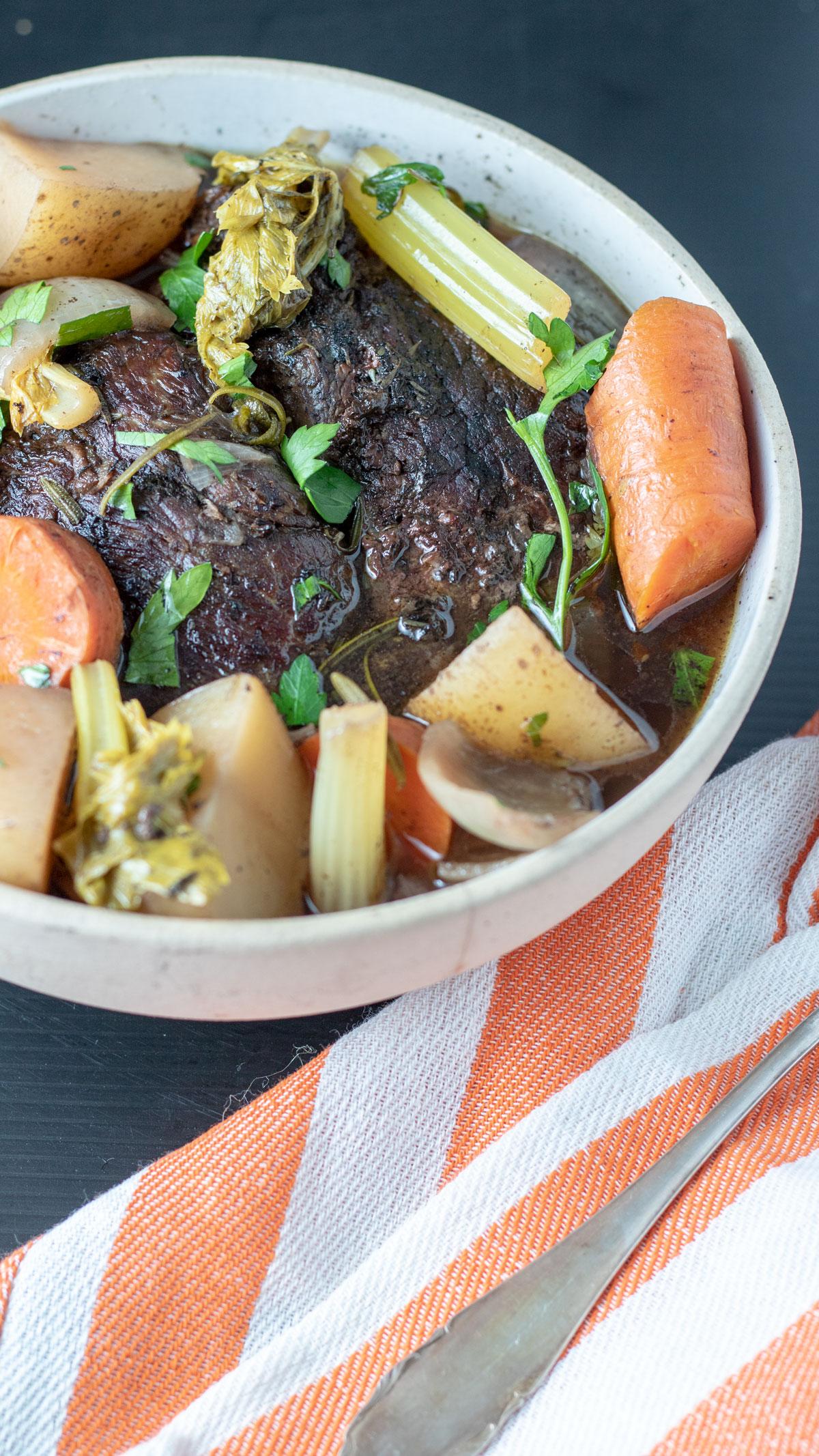 Pot roast in large serving bowl.