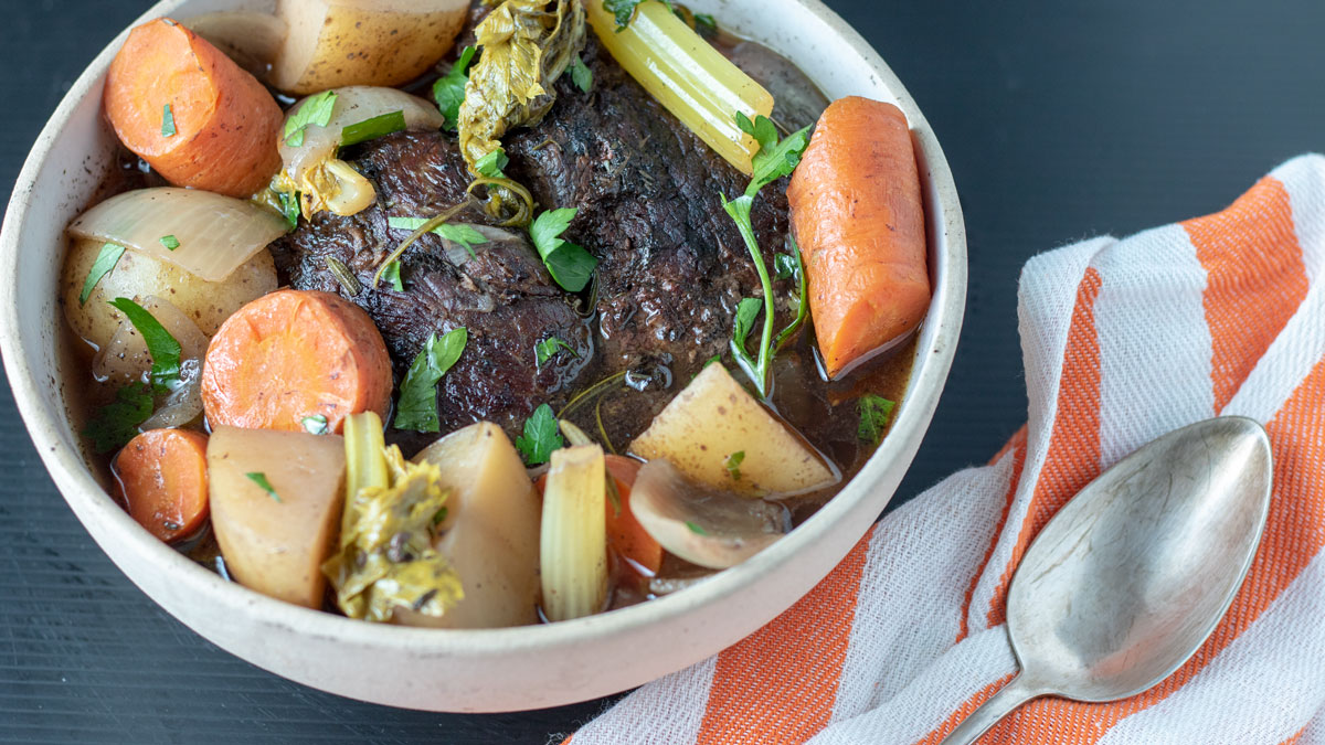 Whole slow cooker pot roast in serving bowl.