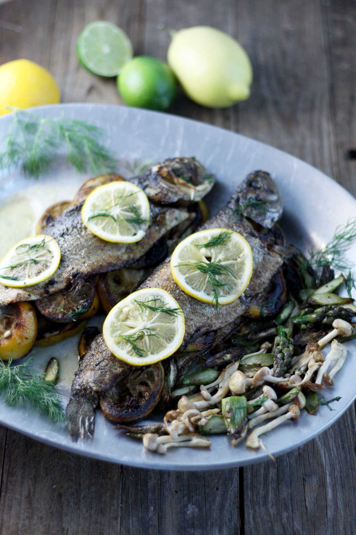 rainbow trout with lemon on platter