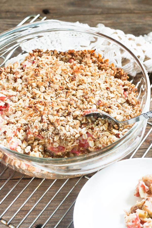 Rhubarb Custard Crisp with spoon scooping it out