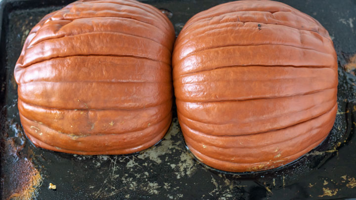 Roasted pumpkins on baking sheet.