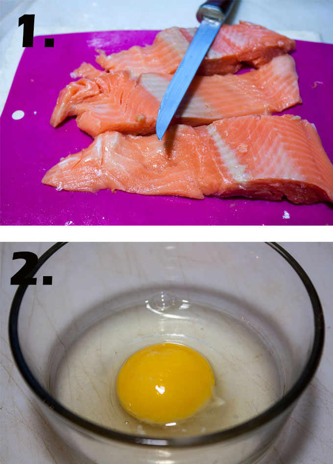 Trimmed salmon fillet. Egg broken into bowl.