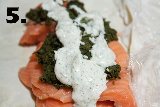 Salmon placed on phyllo dough with spinach and aioli.