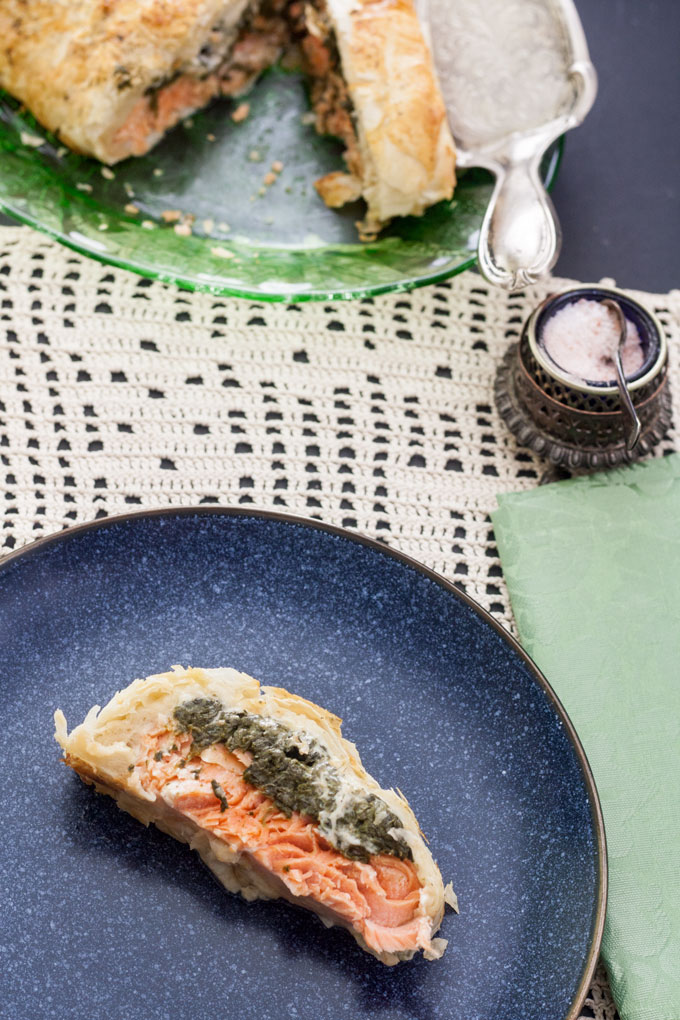 slice of salmon en croute on blue plate