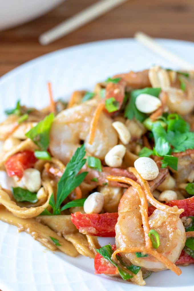 white plate with colorful stir fry