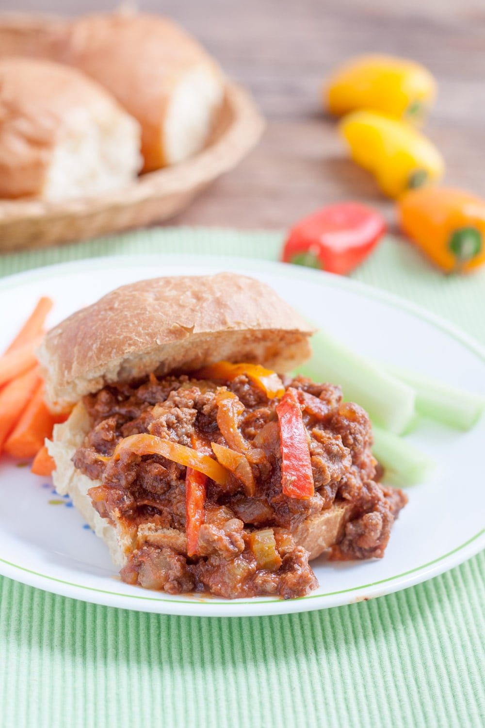 sloppy joe with orange read and yellow pepper strips