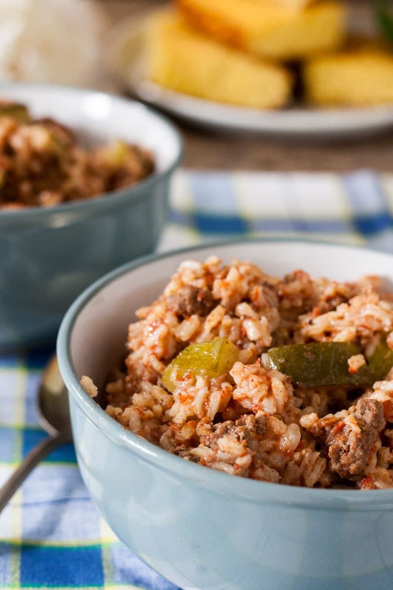 easy spanish rice in gray bowls with cornbread.