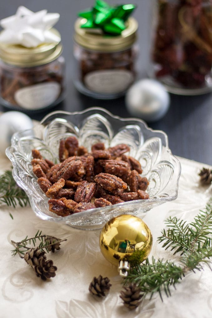 Spicy nuts in glass bowl and packed in decorated canning jars.