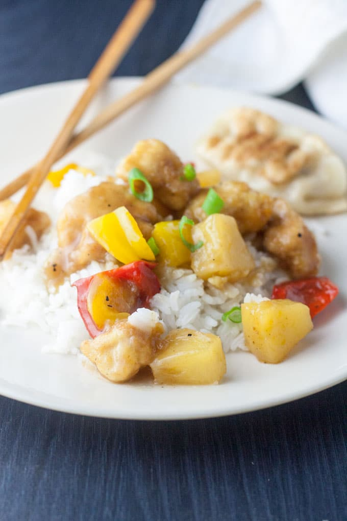 sweet and sour chicken garnished with scallion slices