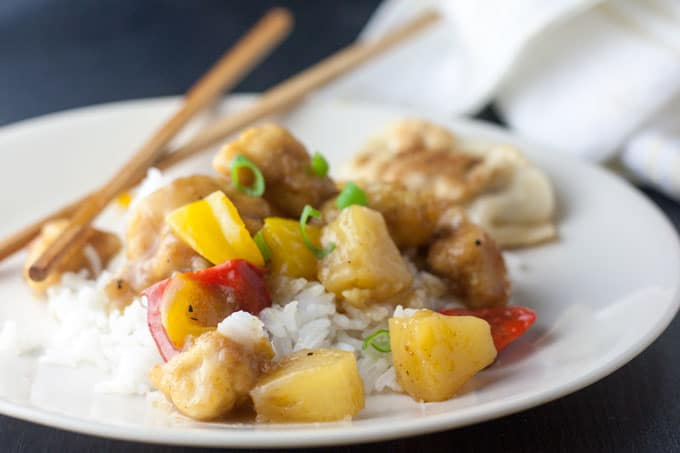 sweet and sour chicken on black board