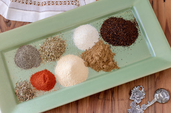 piles of spices on green plate