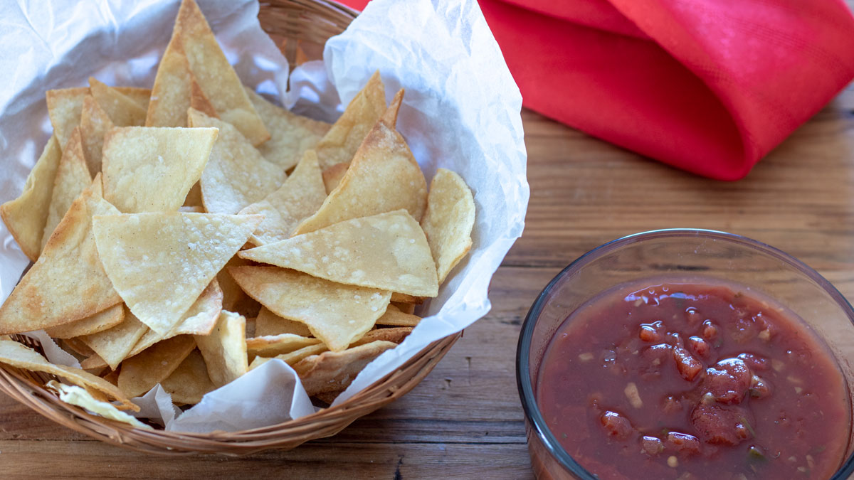 Chips in basket with salsa on the side.
