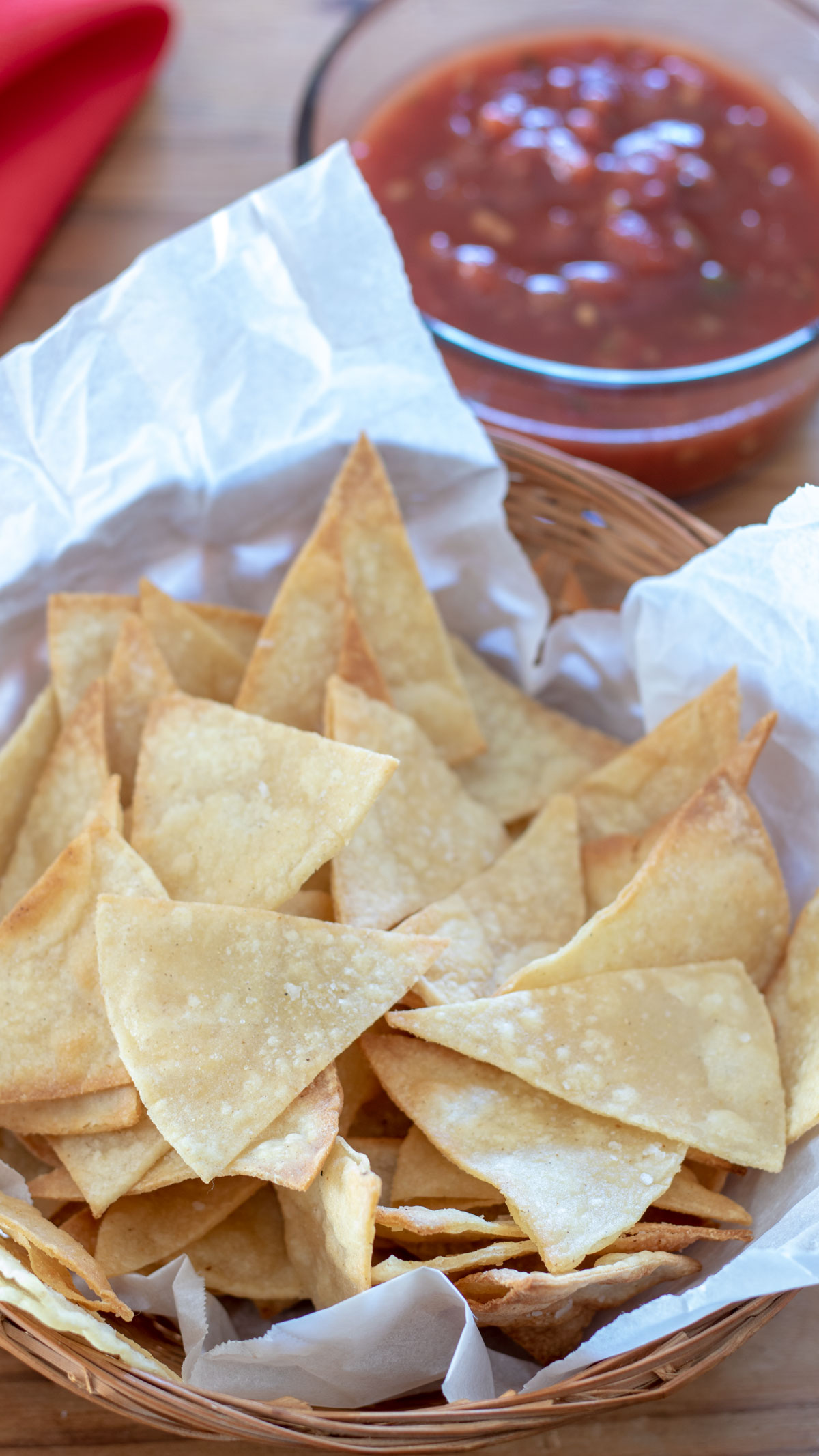 Basket of tortilla chips with bowl of salsa.
