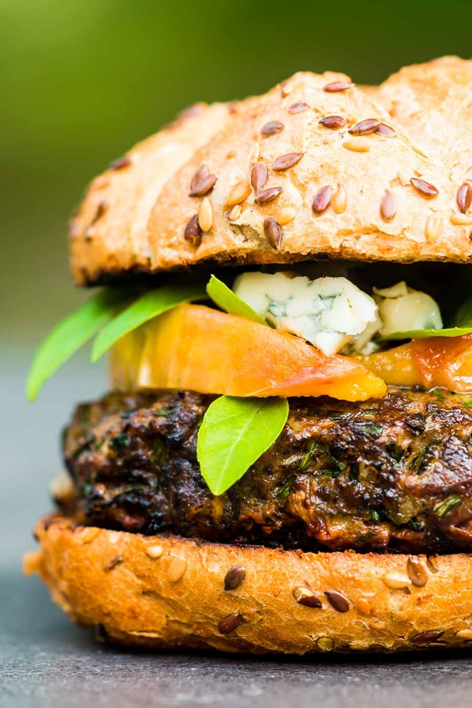 Closeup of venison recipe - Venison burger with peaches and blue cheese showing under towering bun