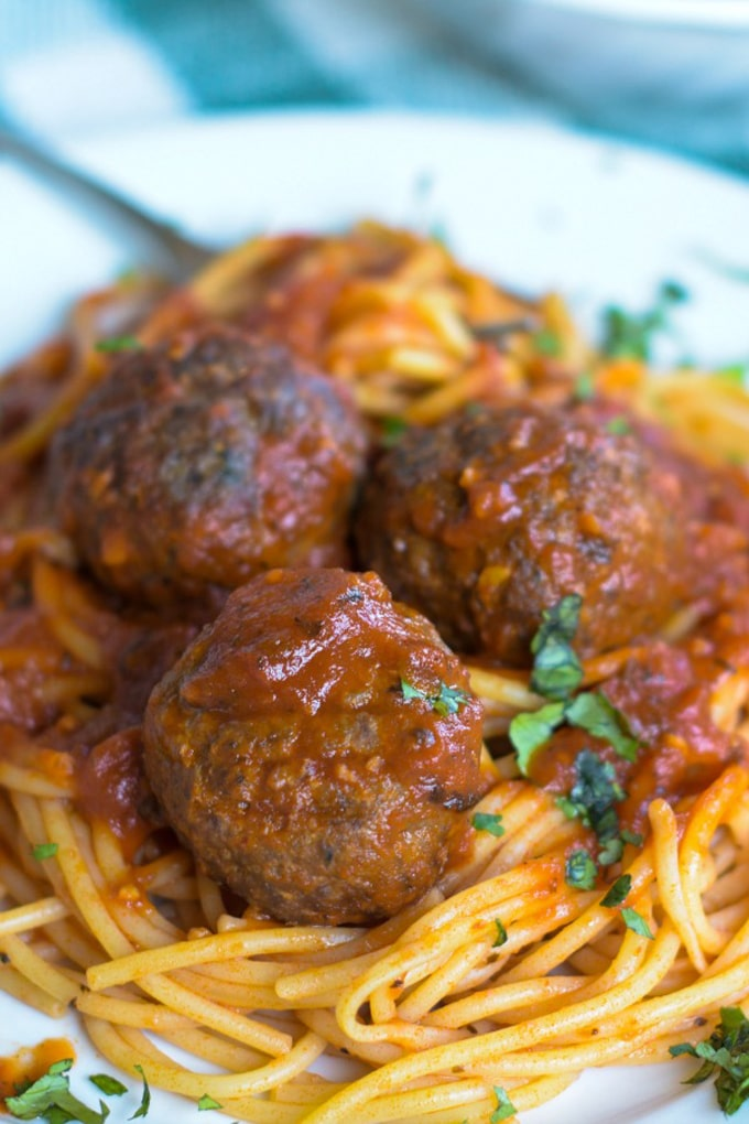 close up venison meatballs on a bed of spaghetti for venison recipes