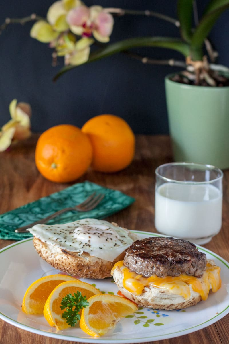 Venison (or Pork) Sausages- Venison breakfast sausage sandwich on hard roll with easy over egg with broken yolk and orange slices