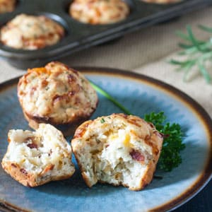 Cheesy herbed bacon muffins on blue plate