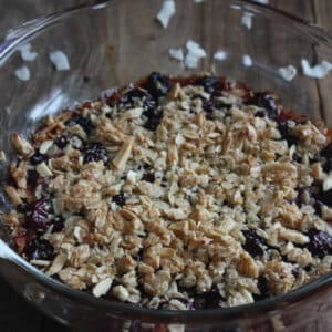 cherry coconut crisp in glass casserole