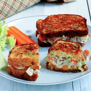 grilled tuna and cheese sandwich on white plate