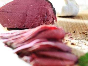 How to Make Home made Corned Venison or Beef - Venison sliced on a bamboo cutting board
