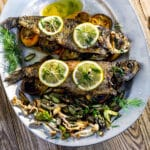 Garlic Citrus Stuffer Rainbow Trout Pinterest image with text overlay.