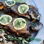 Garlic- Citrus Stuffed Rainbow Trout -Whole rainbow trout topped with fresh dill and lemon slices. with beech mushrooms and asparagus