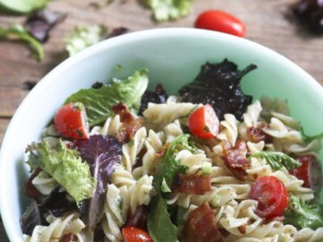 BLT Pasta Salad Rotini pasta with chunks of bacon and lettuce and halved cherry tomatoes