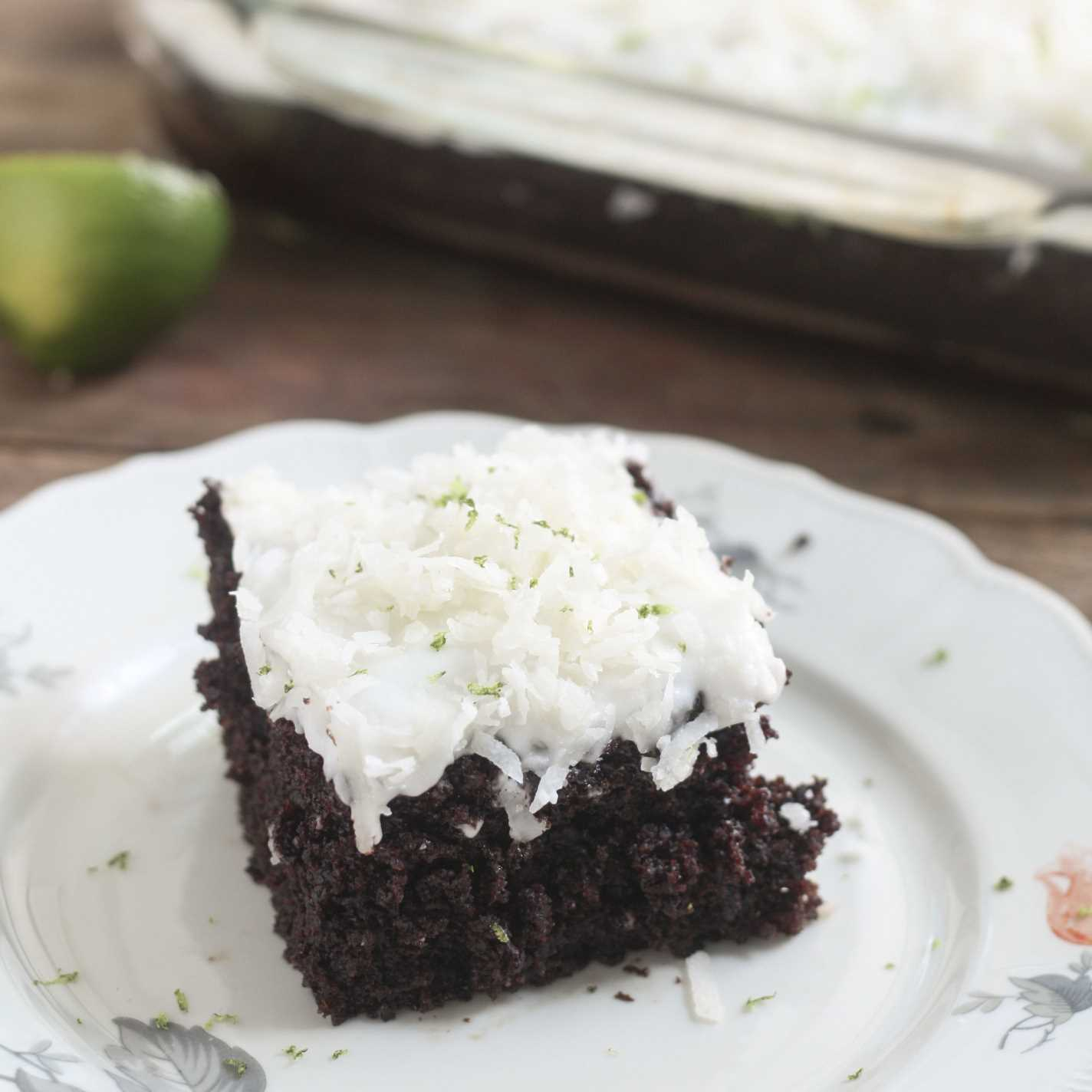 Perfectly Chocolate Chocolate Cake - Very black chocolate cake with white icing topped with shreded coconut and garnished with lime zest