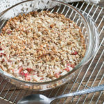 Rhubarb Crisp Gluten and Dairy Free on a metal cooling rack with a metal spoon