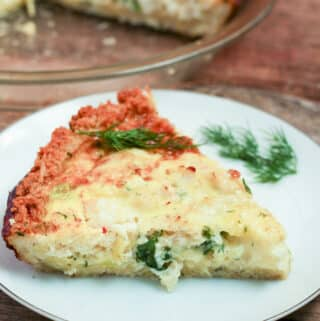 Crab and Shrimp Quiche Chunks of pink from the shrimp and green from the spinach dot this quiche with a golden crust