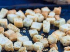 Homemade Croutons on antique metal tray close up
