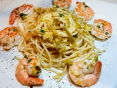Leek and Shrimp Pasta on white plate