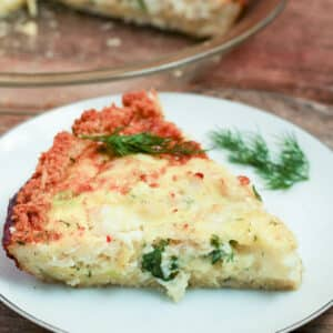 slice of crab and shrimp quiche on white plate
