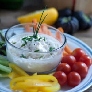 shrimp crab dip in glass bowl with crudites
