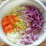 cut cabbage and vegetables in mixing bowl