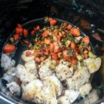 browned alligator meat and vegetables in slow cooker