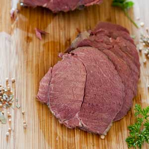 slices of corned venison on wooden board