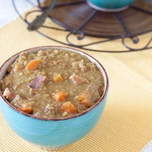 Split pea soup in blue bowl with brown trim
