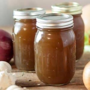 vegetable stock in pint jars on wood board