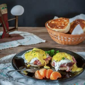 eggs benedict on black plate