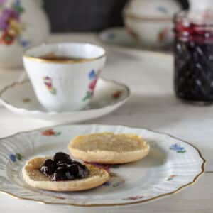 Blueberry Jam on biscuit with antique tea set