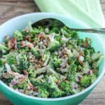 broccoli salad in vintage green bowl.