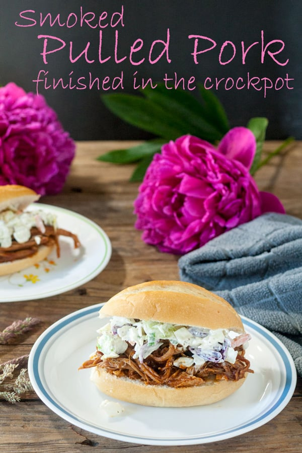 Smoked pulled pork finished in the slow cooker Pinterest image with text overlay.