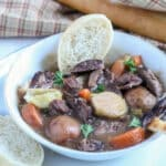 venison neck roast stew in a white bowl