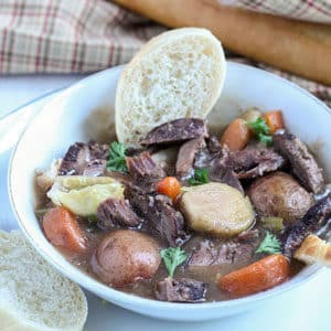 venison neck roast stew in a white bowl