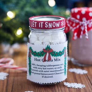 Hot cocoa in a pint jar with instructions, and decorations to gift to family and friends