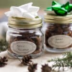 Spicy nuts in glass jars with bows on top