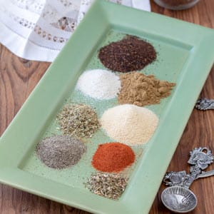 Easy Taco Seasoning spices arranged on green plate