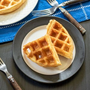 belgian waffles on white and black plate