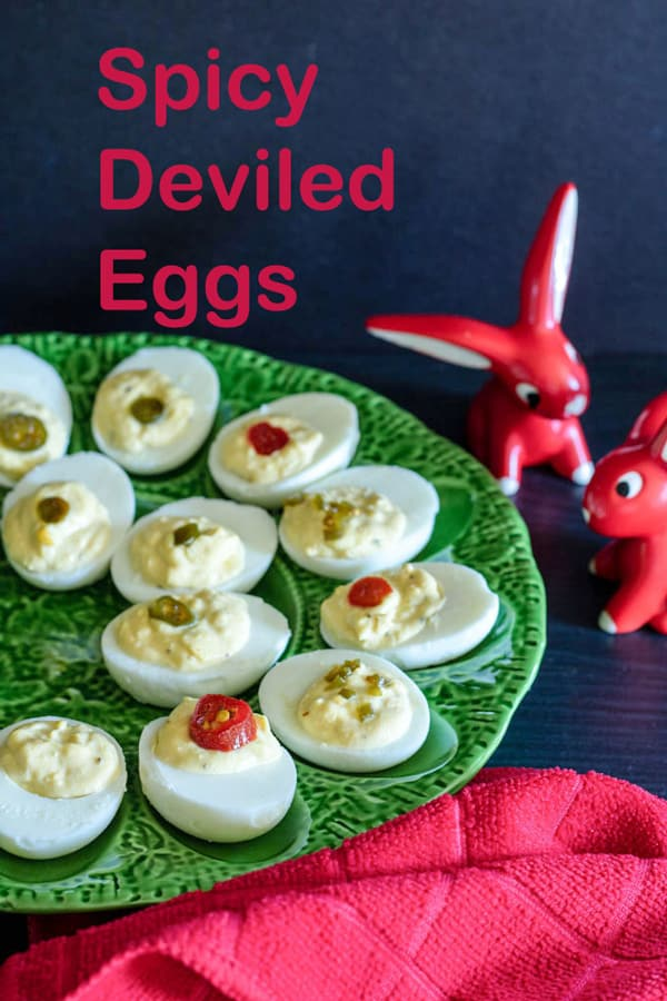 Spicy deviled eggs Pinterest image with text overlay.